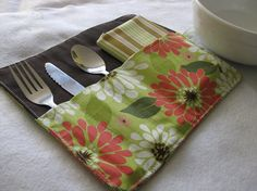 Cutlery holder, also holds napkin. Use more period looking fabric. Use the same idea with narrow channels to use for holding knitting needles or paint brushes.