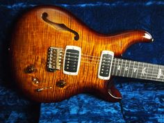"""Buy With Confidence as Guitar Maverick is an Authorized PRS Dealer!Product DescriptionAt the 2013 XPRS, there was a LIMITED PRODUCTION of 100 Guitars.Our Limited Run is a 408 Semi-Hollow with Trem in Black Gold. These guitars are speced as Follows:Carved """"ARTIST GRADE"""" Figured Maple Tops with Single """"F"""" HoleSemi Hollow Mahogany Back25"""" Scale Length, 22 FretsPattern Shape Neck of Peruvian MahoganyEbony Fretboard and Headstock VeneerArtist Birds Inlays (Green Ripple outlines w/ Green Heart…"""