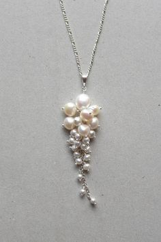 "Signature cluster Freshwater pearl and crystalline pearl pendant set in Fine Silver (99.9% Pure Silver). Looks great with a sweetheart neckline. - Pendant measures approx. 2 1/4"". - Sterling Silver ch"