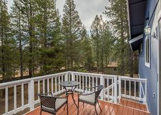 Rear deck accessible from the dining area, leads downstairs to fully-fenced yard