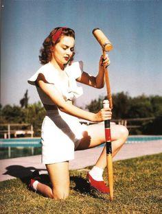 Olivia de Havilland playing croquet