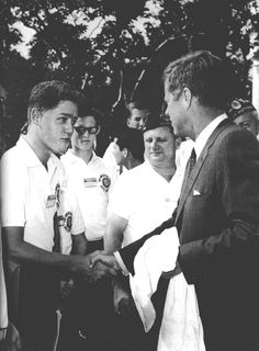 President Clinton and President Kennedy shaking hands.
