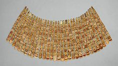 Broad Collar of Rosettes New Kingdom Dynasty 18 Reign of Thutmose III ca. 1479–1425 B.C. Egypt, Upper Egypt; Thebes, Wadi Gabbanat el-Qurud, Tomb of the 3 Foreign Wives of Thutmose III Medium:Gold, gesso, carnelian, jasper, glass