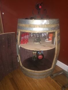 I bought this wine barrel from a local winery for about $70 then converted it to a mini bar.  It wasn't the easiest task in the world but in the end it came out ok...  The hardest part are the hinges; I recommend a heavy duty hinge.  I also did not anticipate the wood shrinking once I cut the door out.  This presented a challenge and in turn I needed to re-secure each panel to the metal ring via metal screws and rivets.