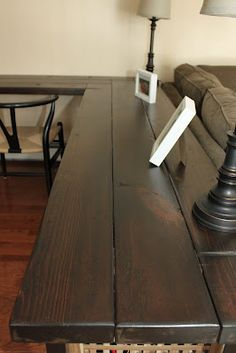 She applied 2 coats of Minwax dark maple and then sealed the whole thing with 3 coats of SafeCoat.  Try this
