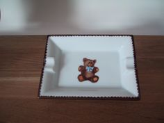 little tray hand painted on  limoges porcelain, with small bear and sky blue tye