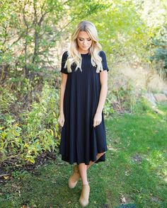 We are all over the pretty ribbing details on our new Teagan Black Ribbed Tee Shirt Dress!  Shop now!