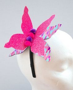 HOLIDAY SALE!!! 50% OFF UNTIL JAN 1, 2017 USE CODE: HOLIDAY2017  This is a fairy tale kind of headband. This large 3D butterfly headband is made of painted leather and neon pink glitter felt. The pieces were hand cut, assembled, and glued with a strong resin bond. One size fits most. This headband is very soft, comfortable, and lightweight.  Please check my shop for more unique leather accessories! https://www.etsy.com/shop/byjaetao   Whats a better way to strike up a conv...