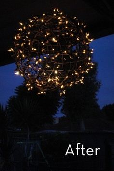 DIY hanging light - made from wire hanging baskets & christmas lights (and those strings that are half way burnt out but still good for a project like this).