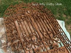 Faux Iron Gate made from empty toilet paper rolls. This is such a neat project I saved it to my PC in case they take it down.