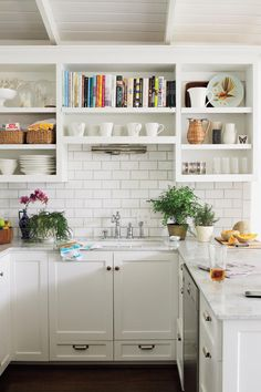 Small Modern White Kitchen. I don't like the open cabinets because it can get messy, but I love the idea of open shelving for cookbook storage