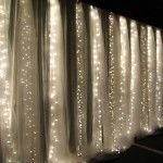 waterfall wall...white string lights and tulle