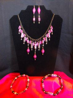 Stunning set in black, pinks and silver.  I have handpainted all the paper beads that are in this set.  Accented with glass and metal beads.  $39.00