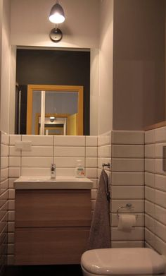 Subway tiles, yellow door. Ikea - godmorgon cabinet, odensvik washbasin.
