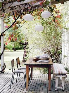 Outdoor Decor - like the pergola, flower vines, lights and lanterns