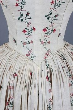 Detail back view, robe à l'Anglaise, c. 1770-1780. Cream lawn delicately embroidered in chain stitch with stripes and sprigs of pinks, convolvulus, dog roses, honeysuckle, tied with pink bows.