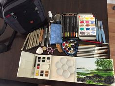 "Watercolor Travel Kit DaVinci and Rosemary travel brushes, Daniel Smith mini tin, Winsor Newton compact, Caran D'Ache watercolor pencils, Pigma pens, Pentel water brushes, a Strathmore 140lb journal, 3-1/2"" ceramic flower for mixing-everything I could possibly need and it all fits into a perfect shoulder strapped 10x14 bag. It's been tested on my trip to Hawaii!"