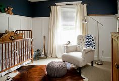 davinci jenny lind crib with cowhide rug and beige curtains also white panel walls for modern nursery room ideas
