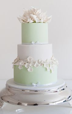 Pretty pale green wedding cake with white fondant flowers // Coco Cakes