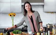 """Mary McCartney, a cookbook author and a daughter of Paul McCartney, preparing an eggplant wrap during a visit in New York, Nov. 13, 2012. The recipes in Mary McCartney's book, """"Food,"""" reflect her upbringing, as well as the way she tends to cook for her brood in London now."""