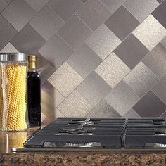 Aspect peel-and-stick tiles are a decorative metal that provides the look of custom metal backsplash at a fraction of the cost. The metal tiles have a solid polyethylene core sandwiched between alumin Diy Backsplash, Stick On Tiles, Kitchen Decor, Kitchen Backsplash, Decor, Metallic Backsplash, Trendy Kitchen Backsplash, Diy Kitchen, Brick Backsplash Kitchen