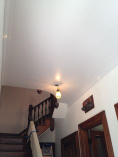 Farrow & Ball's Blackened No. 2011 on ceiling (Estate Eggshell) and crown (Full Gloss). Apartment Painting, Entry Hall, Eggshell, Farrow Ball, Track Lighting, Stairs, Crown, Ceiling Lights, Colors