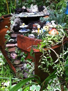 Made from a broken pot, thrift store fines and some fairy garden stuff