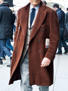 Double-breasted topcoat with those single monks.