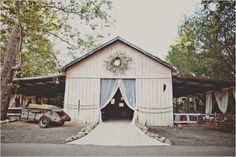 It's all about the BIG wreath and sheer drapes! Reception in Barn at Dos Pueblos Ranch