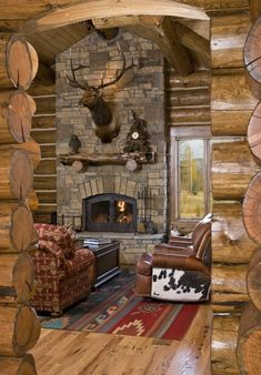 A little rustic, a little western.... perfect lodge living room. Love the cowhide chair.