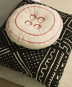 Couldn't help but try to make my own version of a Big Button Pillow I saw online. I changed it up by using a red fabric marker on my natural twill fabric. If you...