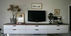 """Modified - Ikea """"Stolman"""" cabinets. 3 placed together with reclaimed wood on top."""