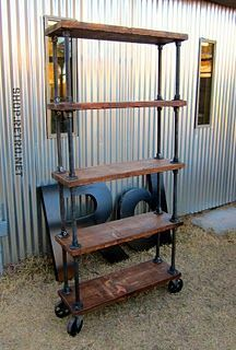 Diy this industrial office shelving on casters with galvanized pipe, plumbing flanges and industrial casters. (Buy the materials from a plummer and you'll pay 75% less than a hardware store!)