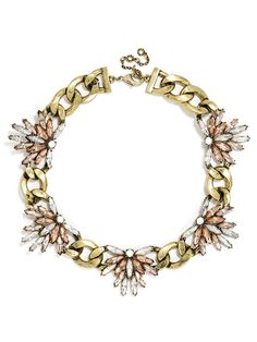 Sharp marquise stones give extra edge to oversized chain links, with gemstone embellishment.