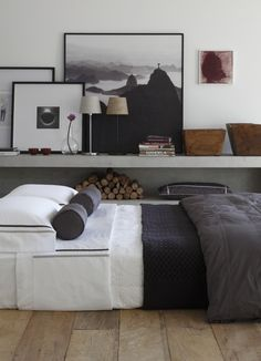 Black frames, wooden pots and layered bedding. http://www.raftfurniture.co.uk/wavy-teak-pot-natural-finish-1482.html