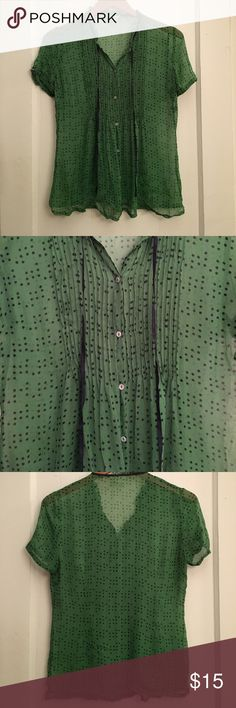 Sheer polka dot blouse Sheer green with navy polka dots and tie detail at neck. Bib detailing and ruffle collar with delicate pearl buttons. Brand is lil from Anthropologie. Flowy fit measures about 18 inches armpit to armpit. Anthropologie Tops Button Down Shirts