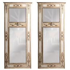 A Fine Pair Italian Neoclassic Painted and Silver Gilt Mirrors | From a unique collection of antique and modern trumeau mirrors at http://www.1stdibs.com/furniture/mirrors/trumeau-mirrors/