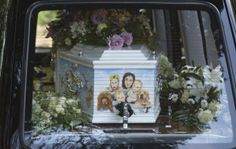 A hearse carrying the coffin of Peaches Geldof, painted with a picture of her family, arrives for her funeral service at the St Mary Magdalene and St Lawrence church in Davington, southeast England April 21, 2014. Geldof was found dead at her home on April 7, 2014. REUTERS/Neil Hall