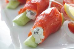 Have fun with appetizer presentation for these Passover dairy recipes. It's a chance to use your creativity, even a touch of whimsy, to put a twist on this smoked salmon opener. To make it really festive, use the green part of a scallion, tied as a bow, to secure each salmon roll.