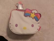 Like New! Hello Kitty Shoulder Bag!  Purse is in the shape of Hello Kitty's Head primarily in the color white!  Never been used!