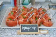 ABC Storybook Baby Shower: love the presentation...mini chalkboars {Amazon} on Scrabble stands with chalk, grapefruit salad in glass cups + spoons {from Pier 1}