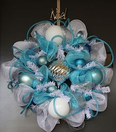 Lovely turquoise, white and silver wreath.  $117.95