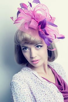 The Kentucky Derby is all about hats and headwear! We love this frothy fascinator in springtime purples and pinks.