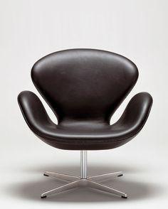 Swan by Arne Jacobsen  http://www.stardustmoderndesign.com/2012/05/arne-jacobsen-swan-chair.html