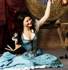 Belle reading and drinking iced tea. (She and Regina are the only two in the promo shot laughing, possibly at each other.) | Magic has returned.