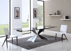 Modrest Titan Modern Extendable Black Glass Dining Table VGGLDT-G428 Product : 72028 Features: - 10mm Black Tempered Glass Top - Extendable - 2 Extension Leaves - Black Powder Coated Steel Double Pede