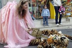 """from Berlin, woman protesting """"pinkifizierung"""" of toys and Barbie's dreamhouse. My sentiment is same as the little girl's: WTF lady?"""