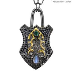 Padlock pendant, with silver, emerald, moonstone, sapphires and diamonds. From Abhaas Jewels.