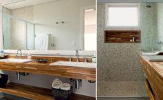 Para levar a natureza para dentro do banheiro de 7 m² na suíte principal da casa na praia no litoral norte de SP, a arquiteta Ana Karina Abud projetou o boxe c/revestimento de seixos telados na cor areia.  Irregulares, os seixos evitam escorregões na área molhada. Fora dela, o piso é de porcelanato. Abaixo da janela,um nicho com madeira teca, que também está na bancada com uma prateleira embaixo.