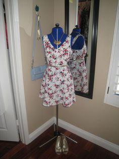 Dolce and Gabbana, Kate Spade, blue purse, floral dress, gold belt, gold necklace, gold pumps, gold headband, outfit